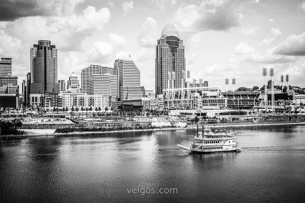 Cincinnati skyline and riverboat black and white picture. Includes downtown Cincinnati city office building, Great American Ballpark, Great American Insurance Group Tower, Omnicare building, US Bank building, and Scripps Center building. Photo Copyright © 2012 Paul Velgos with All Rights Reserved.