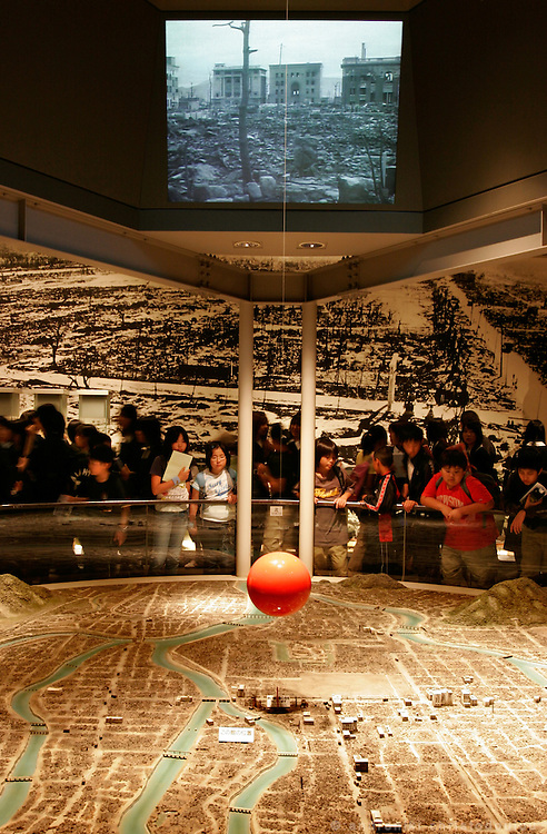 Hiroshima Peace Memorial Museum. Schoolchildren watching the reproduction of the city as it was after the bombing.