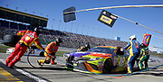 Kyle Busch (18) makes a pit stop in the NASCAR Cup Series auto race at Kansas Speedway in Kansas City, Kan., Sunday, Oct. 22, 2017. (AP Photo/Colin E. Braley)