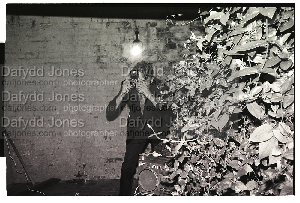 Dafydd Jones photographing with an Olympus rangefinder in 1981.