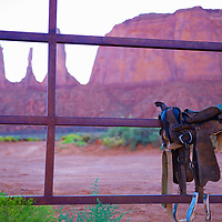 Saddle up! Exploration of a timeless valley by traditional means - horseback. The 3 sisters mesa in the background awaits.