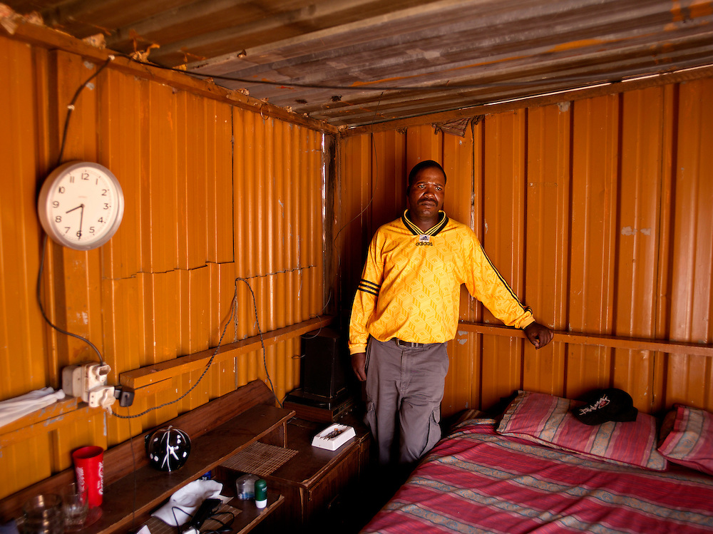 Patrick Dhlamini (b. 1973), currently lives in a tin shack behind his family's home.  After spending his youth as part of the MK he currently has no job, no home and no prospects for work.