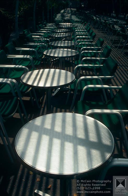 Tables outside a cafe with interesting shadow patterns cast upon them in Barcelona, Spain...Media Usage:.Subject photograph(s) are copyrighted Edward McCain. All rights are reserved except those specifically granted by McCain Photography in writing...McCain Photography.211 S 4th Avenue.Tucson, AZ 85701-2103.(520) 623-1998.mobile: (520) 990-0999.fax: (520) 623-1190.http://www.mccainphoto.com.edward@mccainphoto.com
