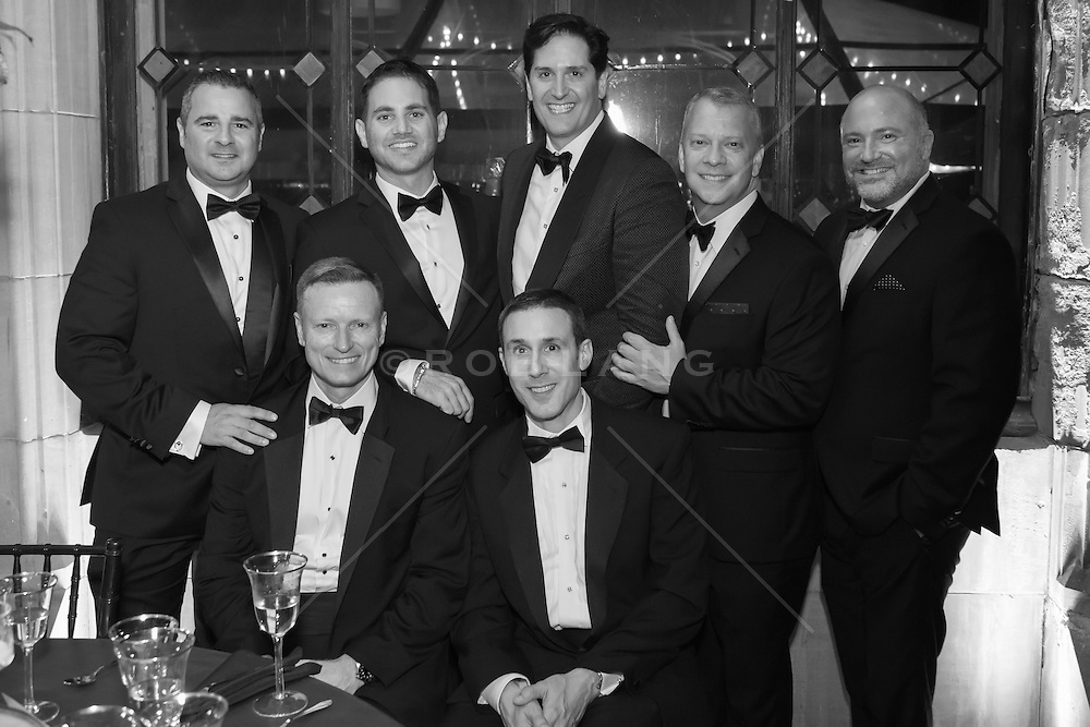 men in tuxedoes at a wedding