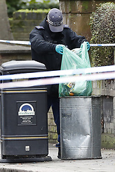 © Licensed to London News Pictures. 06/02/2019. London, UK. Police conduct a search near the crime scene on Westbridge Road in Battersea where a 19 year old man was fatally stabbed last night. Police have arrested two men. Photo credit: Peter Macdiarmid/LNP