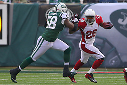 Dec 2, 2012; East Rutherford, NJ, USA; Arizona Cardinals running back Beanie Wells (26) runs with the ball while being chased by New York Jets outside linebacker Bryan Thomas (58) during the first half at MetLIfe Stadium.