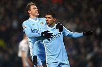 Football - Premier League - Manchester City vs. Fulham<br /> Edin Dzeko joins Sergio Aguero of Manchester City in his celebrations following the opening goal at the Etihad Stadium