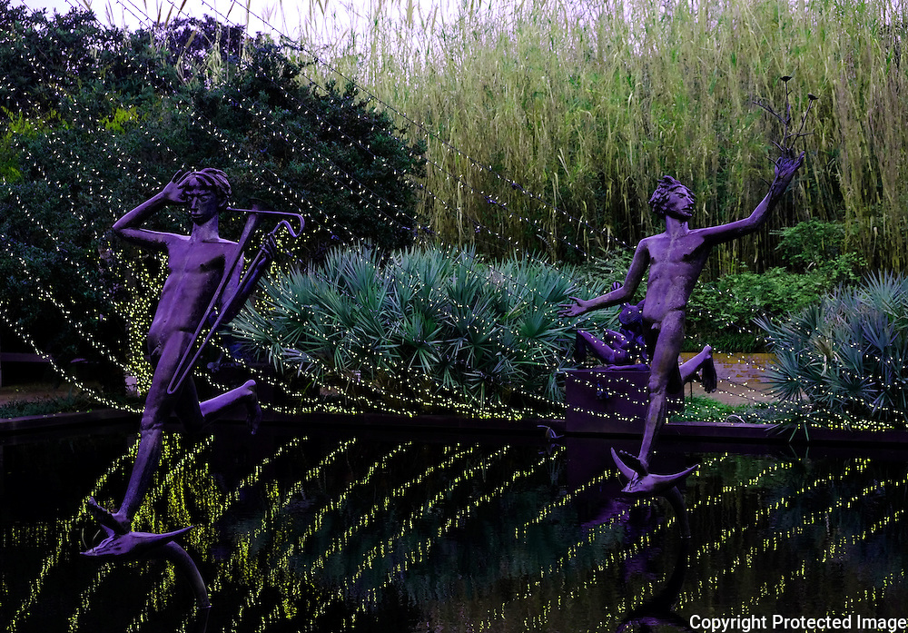 Brookgreen Gardens, in Murrells Inlet, South Carolina, is a sculpture garden and wildlife preserve which includes several themed gardens with American figurative sculptures and trails of nature reserves on the 9,100 acre property.  It was founded by Archer Milton Huntington and his wife Anna Hyatt Huntington to feature sculptures by Anna and her sister Harriet Hyatt along with other American Sculptors.   I was built on a former rice plantation - Brookgreen Plantation.  During the Christmas season many of the sculptures and live oak trees are dressed in brilliant lights.  It is one of the most popular attractions in South Carolina. These are muses playing in a pool or fountain.
