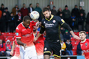 Salford City's Tom Elliot and Crawley Town's Ollie Palmer contest an aerial ball  during the EFL Sky Bet League 2 match between Salford City and Crawley Town at the Peninsula Stadium, Salford, United Kingdom on 8 February 2020.