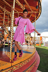 TOLULA ADEYEMI at the 2012 Veuve Clicquot Gold Cup Final at Cowdray Park, Midhurst, West Sussex on 15th July 2012.