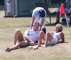 A pregnant Zara Phillips plays in the Eventers vs Riders charity Polo  The Rundle Cup, whilst husband Mike Tindall watches on at Tidworth Polo Club,Wiltshire, United Kingdom<br /> Saturday, 13th July 2013<br /> Picture by i-Images