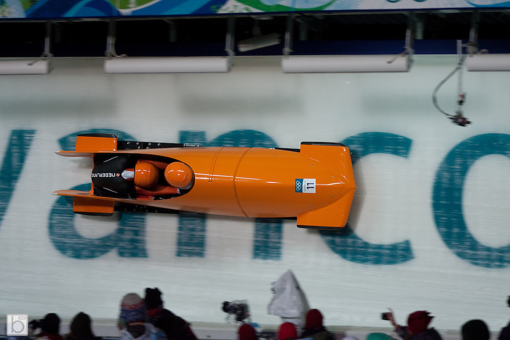 The Netherland's 1 woman's bobsled driven by Esme Kamphuis with Tine Veenstra on the brakes at the 2010 Winter Olympics Woman Bobsled competition at the Whistler Sliding Center in Whistler, BC, Canada. (Photo/Todd Bissonette - www.usabobsledphotos.com)
