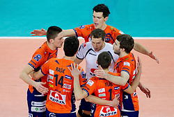 Players of ACH celebrate during volleyball match between ACH Volley LJUBLJANA and  PGE Skra Belchatow (POL) of 2012 CEV Volleyball Champions League, Men, League Round in Pool F, 4th Leg, on December 20, 2011, in Arena Stozice, Ljubljana, Slovenia. Belchatow defeated ACH 3-0. (Photo By Vid Ponikvar / Sportida.com)