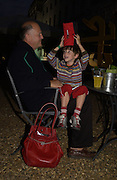 Icaro Kosak and his son Teodoro. Film Four and Somerset House host a Reception and open air screening of Close Encounters of a third Kind. Somerset House, 16 August 2005. ONE TIME USE ONLY - DO NOT ARCHIVE  © Copyright Photograph by Dafydd Jones 66 Stockwell Park Rd. London SW9 0DA Tel 020 7733 0108 www.dafjones.com