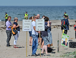 Protesters gathered amid tight security at the Trump Turnberry resort, where President Trump and his wife Melania are staying on their trip to Scotland.<br /> <br /> &copy; Dave Johnston / EEm