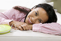 Woman Lying Down with Portable CD Player