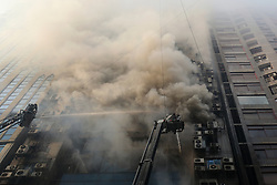 March 28, 2019 - Dhaka, Bangladesh - Firefighters try to control fire in office building in Dhaka, Bangladesh on March 28, 2019. At least 25 people were killed and 70 others injured in a fire that broke out at office building in Dhaka. (Credit Image: © Rehman Asad/NurPhoto via ZUMA Press)