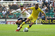 Leeds United midfielder, Stuart Dallas (15) and Prestons Alan Browne battle during the Sky Bet Championship match between Preston North End and Leeds United at Deepdale, Preston, England on 7 May 2016. Photo by Pete Burns.