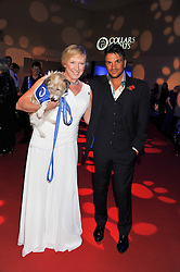 CLARE HORTON Chief Executive Officer? Battersea Dogs & Cats Home holding her dog Wilma and PETER ANDRE at the annual Collars & Coats Gala Ball in aid of Battersea Dogs & Cats Home held at Battersea Evolution, Battersea Park, London on 11th November 2011.