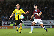 Burton Albion forward Liam Boyce (27) and Aston Villa defender James Bree (16) during the second round or the Carabao EFL Cup match between Burton Albion and Aston Villa at the Pirelli Stadium, Burton upon Trent, England on 28 August 2018.