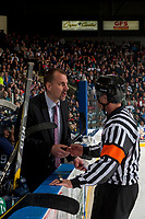 KELOWNA, CANADA - APRIL 30: Seattle Thunderbirds' head coach Steve Konowalchuk stands on the bench and speaks to referee Steve Papp at the start of second period against the Kelowna Rockets on April 30, 2017 at Prospera Place in Kelowna, British Columbia, Canada.  (Photo by Marissa Baecker/Shoot the Breeze)  *** Local Caption ***