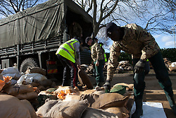 Royal Army helping in Staines. Members of the 1st Regiment Royal Horse Artillery helps along volunteers pumping water and moving sand bags in flooded residential areas in Staines. Staines-upon-Thames, Staines-upon-Thames, United Kingdom. Sunday, 16th February 2014. Picture by Daniel Leal-Olivas / i-Images