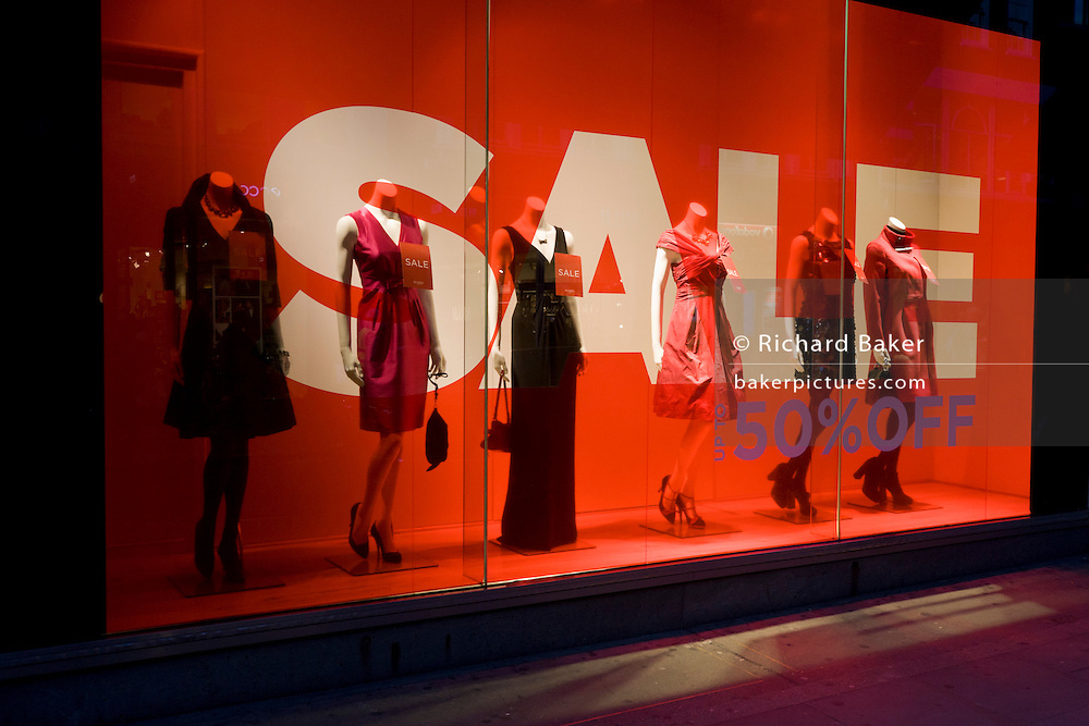 Sale sign and mannequins in a window of clothing emporium Hobbs in London's Long Acre.
