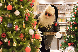 © Licensed to London News Pictures. 02/08/2018. London, UK. A Santa Clause launches the Selfridges Christmas store with a rock-n-roll theme. The Selfridges Christmas Shop is the first to open in the world this year, 145 days before Christmas day. Photo credit: Ray Tang/LNP