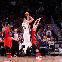 09 April 2018: Denver Nuggets center Nikola Jokic (15) takes a jump shot over Portland Trail Blazers center Zach Collins (33) during the Denver Nuggets 88-82 victory over the Portland Trail Blazers, at the Pepsi Center, Denver, Colorado, USA.