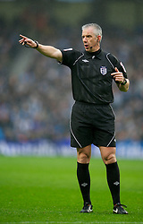 MANCHESTER, ENGLAND - Sunday, January 8, 2012: Referee Chris Foy takes charge of Manchester City versus Manchester United during the FA Cup 3rd Round match at the City of Manchester Stadium. (Pic by David Rawcliffe/Propaganda)