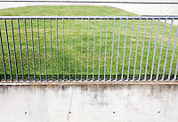 Metal railings in front of grass