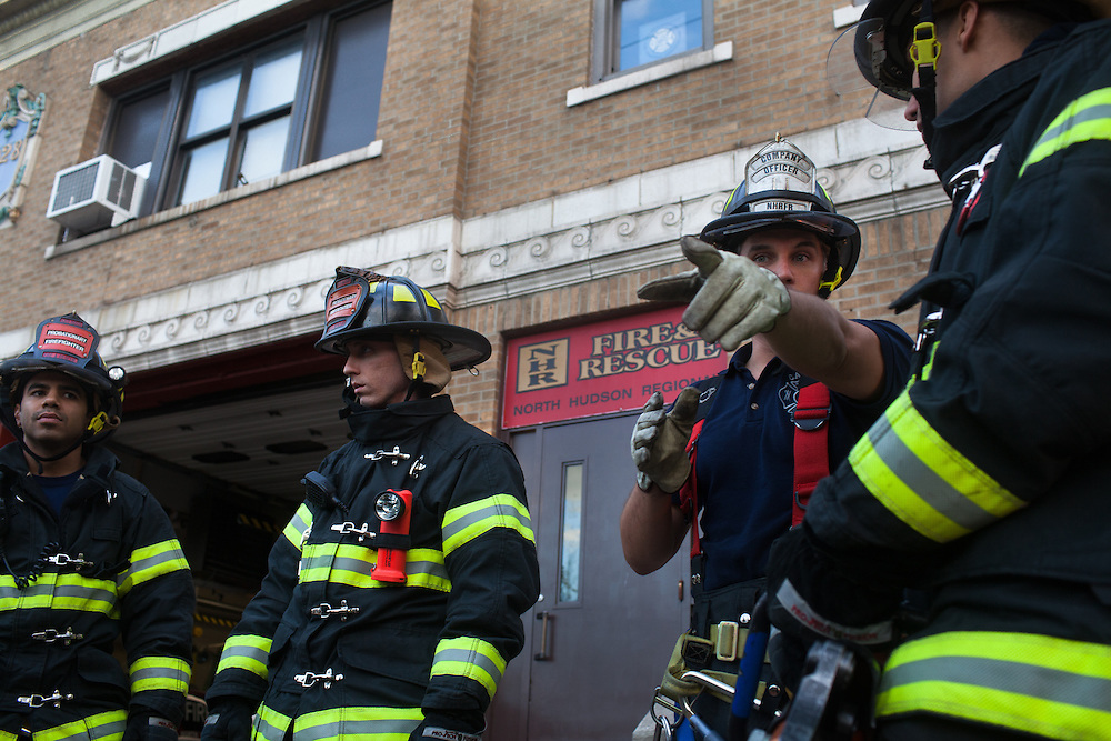 Probationary Fire fighters Victor Ramos, left,and AJ Maresca, with Capt. Joe McLean and probationary fire fighter Andres Godoy, right, at the 16th Street Fire House of the North Hudson Regional Fire and Rescue in Union City, NJ on November 07, 2013. Many vets say after the military they're still looking for a career with a sense of public service. Some vets have found that at the North Hudson Regional Fire and Rescue in New Jersey.