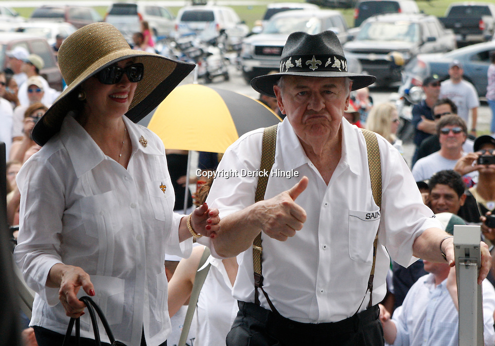 June 8, 2010; Buras, LA, USA; New Orleans Saints owner Tom Benson and his wife Gayle walk up onto the stage where a rally was held at Fort Jackson. The entire team held a rally at Fort Jackson and visited with members of the small Plaquemines Parish fishing community of Buras that has been impacted by the oil spill. Mandatory Credit: Derick E. Hingle-US PRESSWIRE