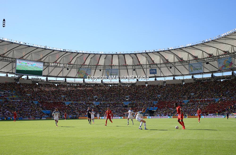 Aleksey Kozlov of Russia tries to stop Divock Origi of Belgium in the Estadio do Maracana stadium - Estadio Jornalista Mario Filho - ost venue of the FIFA 2014 World Cup