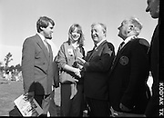 Charles Haughey Visits The Community Games. (T5)..1989..03.10.1989..10.03.1989..3rd September 1989..An Taoiseach, Charles Haughey TD,accompanied by Mr Frank Fahey, TD, Minister of State with responsibility for Youth and Sport attended the Twentieth National Finals of the Community Games at Mosney,  Co.Meath yesterday...Image shows  An Taoiseach,Charles Haughey TD, admiring the medal won by this young lady at the community games.