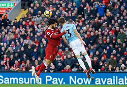 LIVERPOOL, ENGLAND - Saturday, February 24, 2018: Liverpool's Mohamed Salah and West Ham United's Aaron Cresswell during the FA Premier League match between Liverpool FC and West Ham United FC at Anfield. (Pic by David Rawcliffe/Propaganda)