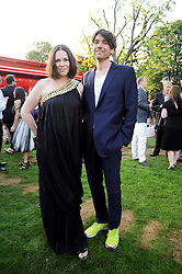 ALEX JAMES and his wife CLARE at the annual Serpentine Gallery Summer party this year sponsored by Jaguar held at the Serpentine Gallery, Kensington Gardens, London on 8th July 2010.  2010 marks the 40th anniversary of the Serpentine Gallery and the 10th Pavilion.