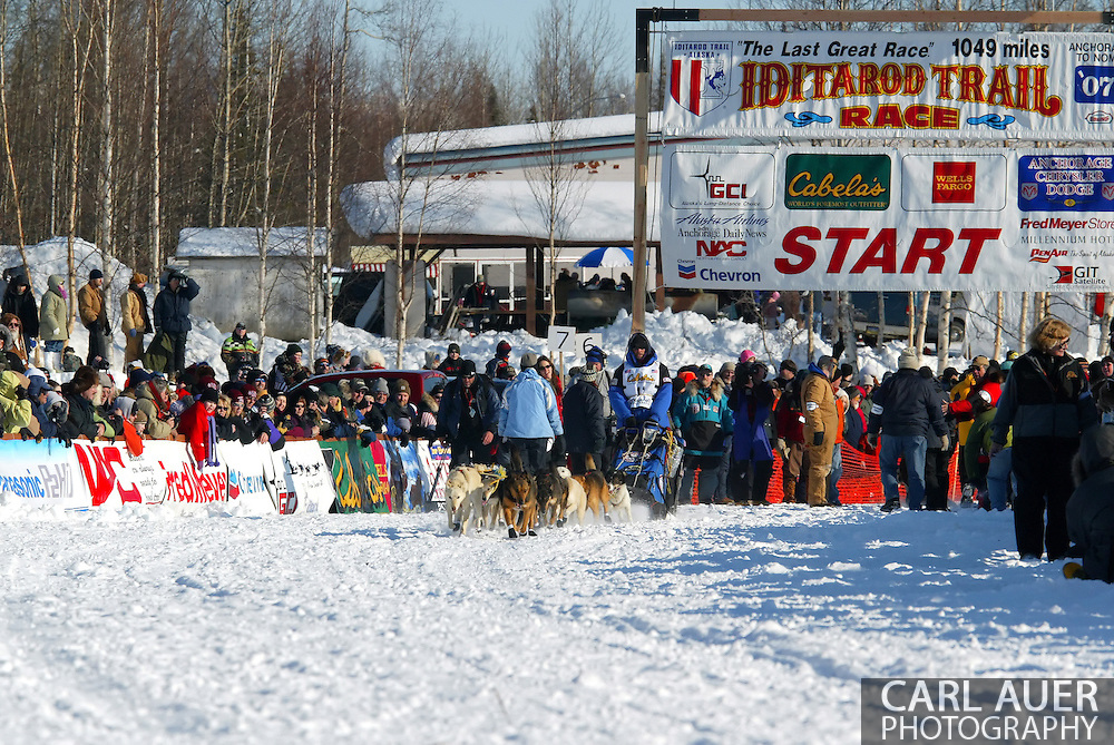 3/4/2007:  Willow, Alaska -  The handlers let go of the dogs and Veteran Jason Barron of Lincoln, MT is on his way in the 35th Iditarod Sled Dog Race