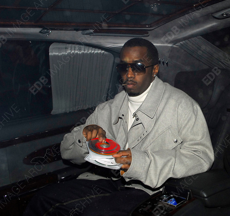 26.MARCH.2007. LONDON<br /> <br /> P.DIDDY LEAVING THE SOHO HOTEL TO GO TO HIS PARTY AT PAPER CLUB, HE WAS GETTING READY FOR IT BY LYING ON THE BONNET OF HIS MAYBACK CAR AND THEN CHOOSING A CD TO LISTEN TO.<br /> <br /> BYLINE: EDBIMAGEARCHIVE.CO.UK<br /> <br /> *THIS IMAGE IS STRICTLY FOR UK NEWSPAPERS AND MAGAZINES ONLY*<br /> *FOR WORLD WIDE SALES AND WEB USE PLEASE CONTACT EDBIMAGEARCHIVE - 0208 954 5968*