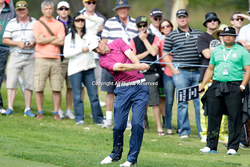 20.10.2013 Perth, Australia. Ross Fisher (ENG) plays an approach shot in the play off against Jin Jeong (KOR) during the final day of the ISPS Handa Perth International Golf Championship from the Lake Karrinyup Country Club.