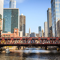 Photo of downtown Chicago skyline at Wells Street Bridge along the Chicago River.