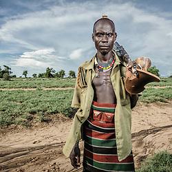 Dassanech man with kalashnikov, Omo Valley, Ethiopia, Africa