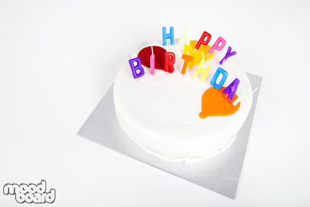 Birthday cake with candles against white background
