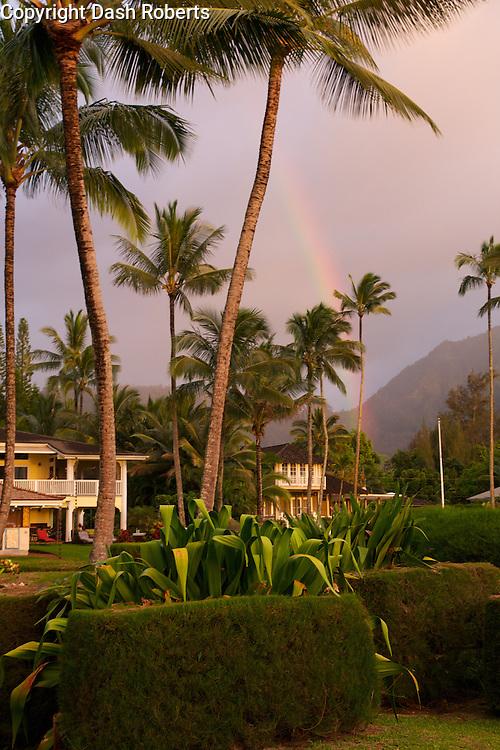 Rainbow over homes on Hanalei Bay Beach, Kauai, Hawaii.