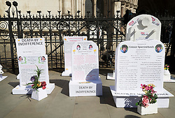 "© Licensed to London News Pictures. 01/05/2018. London, UK. Disability group 'The Distant Voices', which campaigns against euthanasia, erect grave stones outside the High Court as terminally ill man Noel Conway challenges the law on assisted suicide. Mr Conway, who has motor neurone disease, is asking judges to acknowledge his ""basic right to die"". Photo credit: Peter Macdiarmid/LNP"