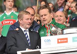 An Taoiseach Enda Kenny congratulates Mayo captain Andy Moran at McHale Park Castlebar after the Connacht Senior Football final.<br /> Pic Conor McKeown