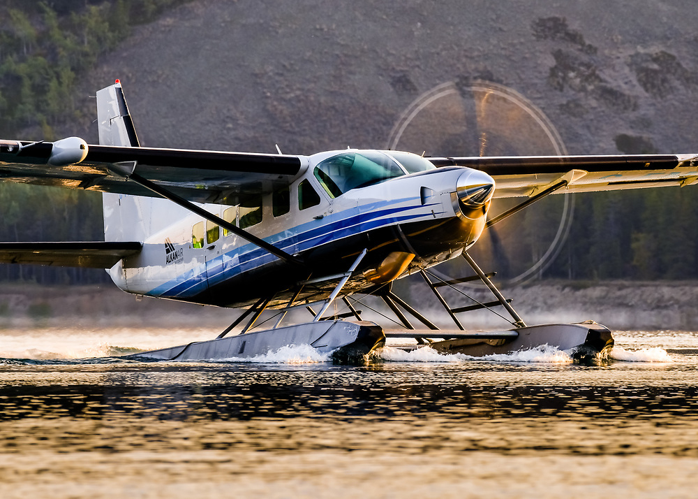 Alkan Air Ltd.'s Cessna 208 Caravan catches the dawn's first rays on warm-up for departure to Wellesley Lake.