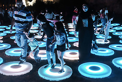June 28, 2017 - Jerusalem, Israel - A Muslim Palestinian family enjoys 'The Pool' by Jen Lewin of the USA in Gan HaBonim outside the Old City walls. Jerusalem launched its 9th International Festival of Light displaying illuminated art installations created by local and international artists. (Credit Image: © Nir Alon via ZUMA Wire)