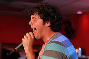 Ryan Wickard, lead singer for Take Cover, performs at Fiesta in Tinley Park, Illinois.