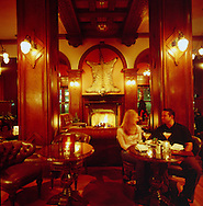 A young couple enjoying cocktails in The Bengal Room in the Empress Hotel, Victoria, BC, Canada